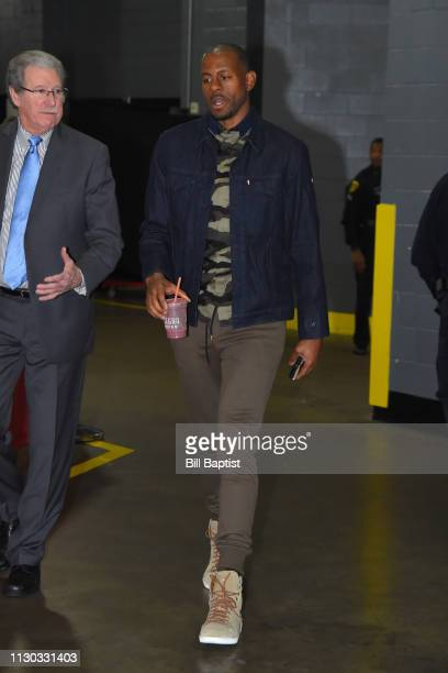 Andre Iguodala of the Golden State Warriors arrives for the game against the Houston Rockets on March 13 2019 at the Toyota Center in Houston Texas...