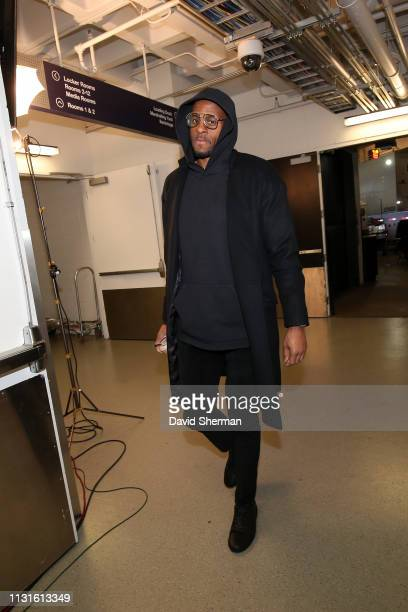 Andre Iguodala of the Golden State Warriors arrives to the game against the Minnesota Timberwolves on March 19 2019 at Target Center in Minneapolis...