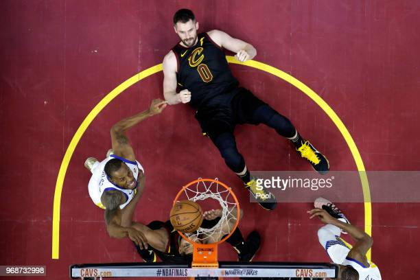 Andre Iguodala of the Golden State Warriors battles for position with Kevin Love and Tristan Thompson of the Cleveland Cavaliers in the second half...