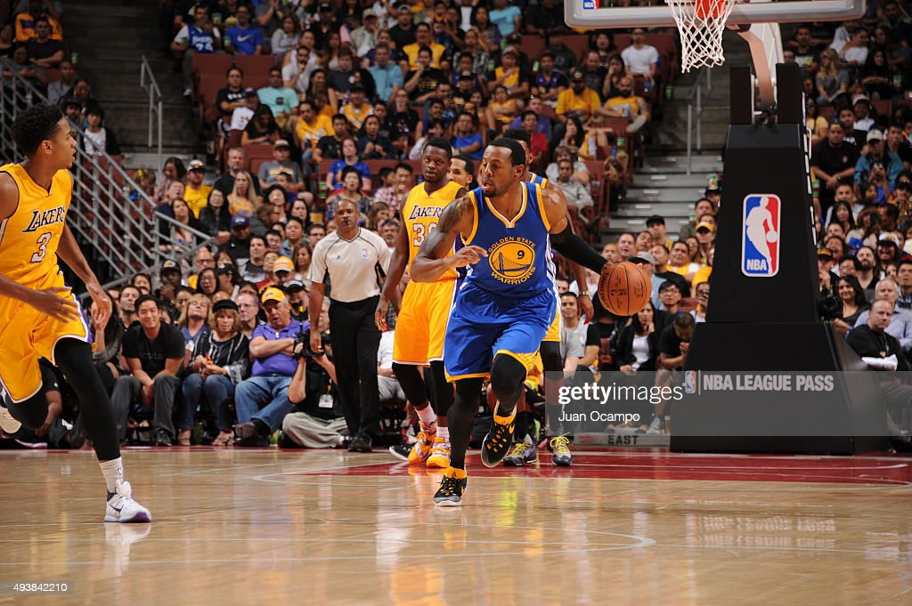 Andre Iguodala #9 of the Golden State Warriors brings the ball up court against the Los Angeles Lakers during a preseason game on October 22, 2015 at Honda Center in Anaheim, California.
