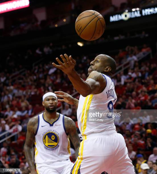 Andre Iguodala of the Golden State Warriors can't handle the pass from DeMarcus Cousins against the Houston Rockets at Toyota Center on March 13 2019...