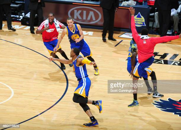 Andre Iguodala of the Golden State Warriors celebrates after hitting the game winning shot against the Atlanta Hawks on January 3 2014 at Philips...