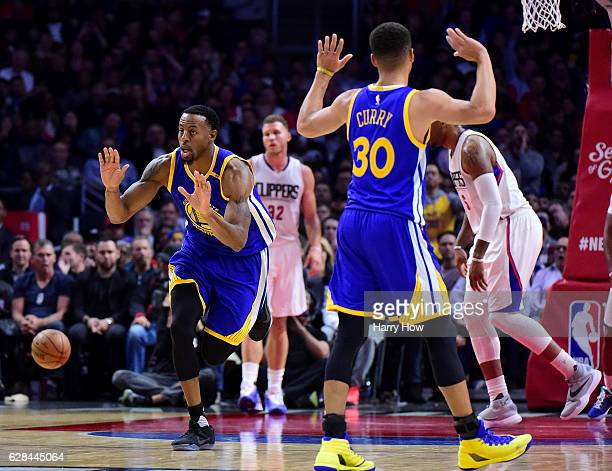 Andre Iguodala of the Golden State Warriors celebrates his dunk with Stephen Curry during a 11598 win over the LA Clippers at Staples Center on...