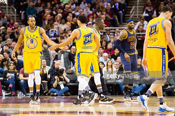 Andre Iguodala of the Golden State Warriors celebrates with Shaun Livingston after Iguodala scores during the first half against the Cleveland...