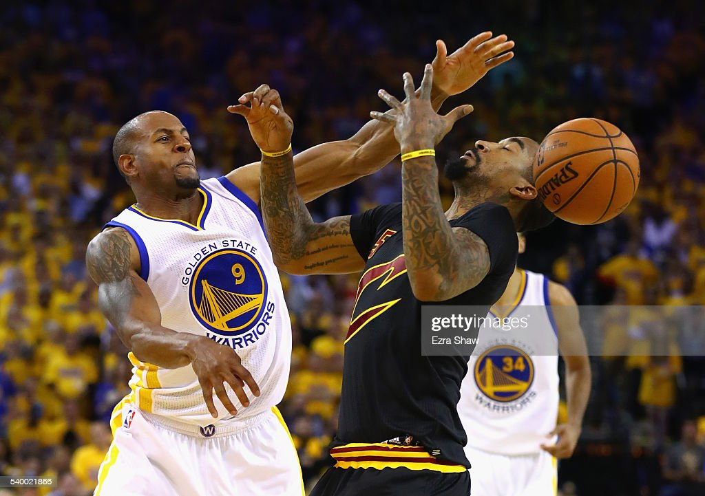 Andre Iguodala #9 of the Golden State Warriors defends J.R. Smith #5 of the Cleveland Cavaliers during the second half in Game 5 of the 2016 NBA Finals at ORACLE Arena on June 13, 2016 in Oakland, California.