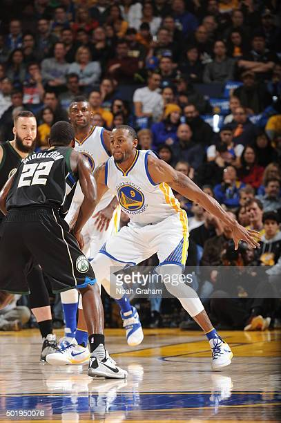 Andre Iguodala of the Golden State Warriors defends Khris Middleton of the Milwaukee Bucks on December 18 2015 at Oracle Arena in Oakland California...