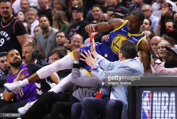 Andre Iguodala of the Golden State Warriors dives into the crowd against the Toronto Raptors in the second quarter during Game One of the 2019 NBA...