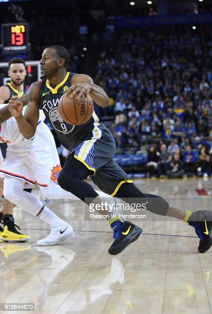 Andre Iguodala of the Golden State Warriors drives towards the basket on Marquese Chriss of the Phoenix Suns during an NBA basketball game at ORACLE...