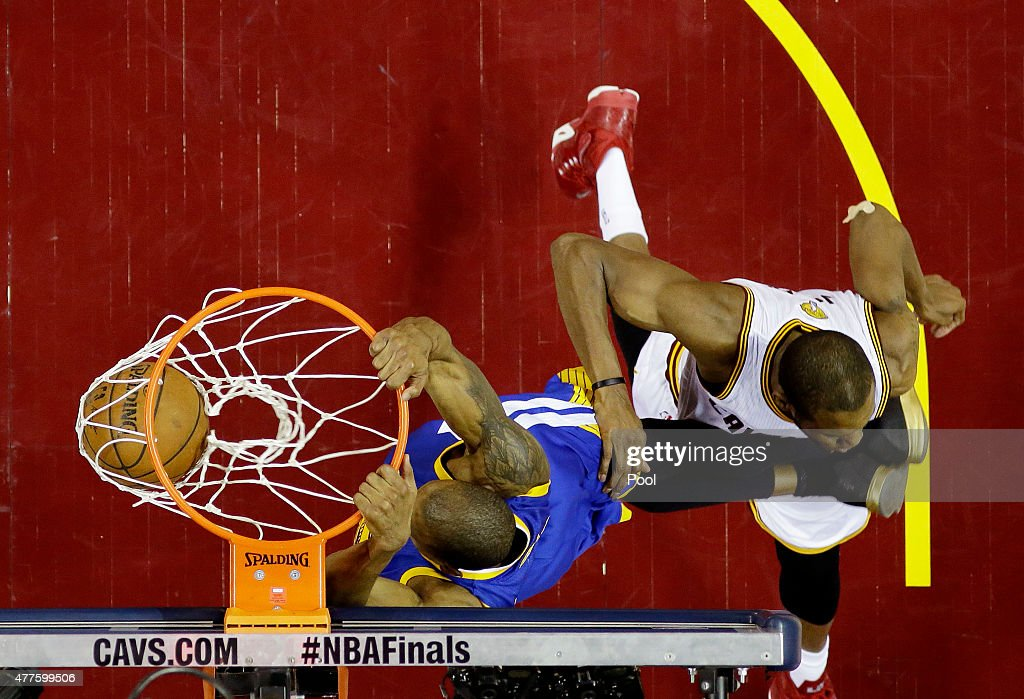 Andre Iguodala #9 of the Golden State Warriors dunks against James Jones #1 of the Cleveland Cavaliers in the third quarter during Game Six of the 2015 NBA Finals at Quicken Loans Arena on June 16, 2015 in Cleveland, Ohio.