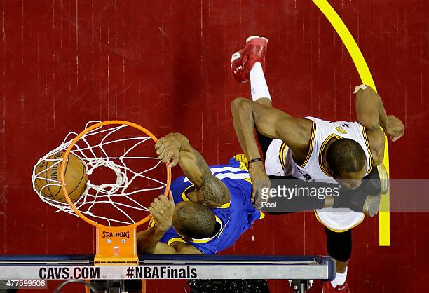 Andre Iguodala of the Golden State Warriors dunks against James Jones of the Cleveland Cavaliers in the third quarter during Game Six of the 2015 NBA...
