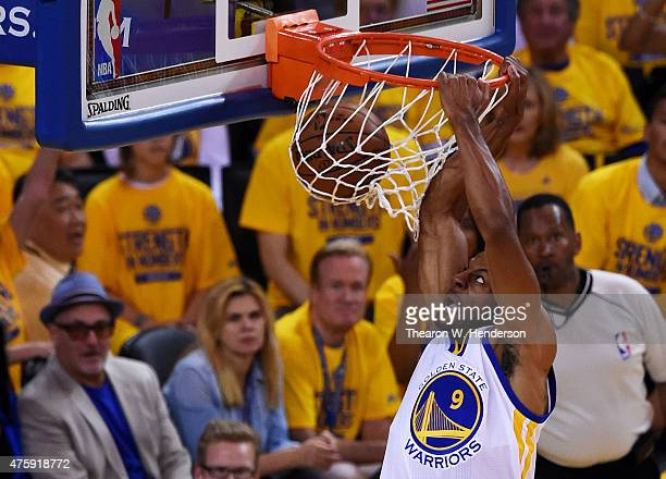 Andre Iguodala of the Golden State Warriors dunks against the Cleveland Cavaliers in the first half during Game One of the 2015 NBA Finals at ORACLE...