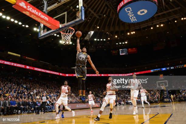 Andre Iguodala of the Golden State Warriors dunks against the Phoenix Suns on February 12 2018 at ORACLE Arena in Oakland California NOTE TO USER...