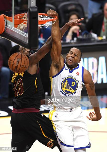 Andre Iguodala of the Golden State Warriors dunks over Tristan Thompson of the Cleveland Cavaliers during Game Three of the 2018 NBA Finals at...