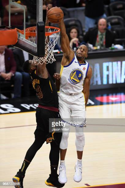 Andre Iguodala of the Golden State Warriors dunks over Tristan Thompson of the Cleveland Cavaliers in the second half during Game Three of the 2018...