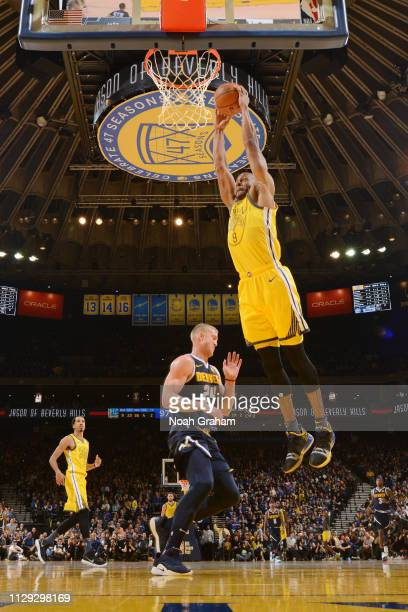 Andre Iguodala of the Golden State Warriors dunks the ball against the Denver Nuggets on March 8 2019 at ORACLE Arena in Oakland California NOTE TO...