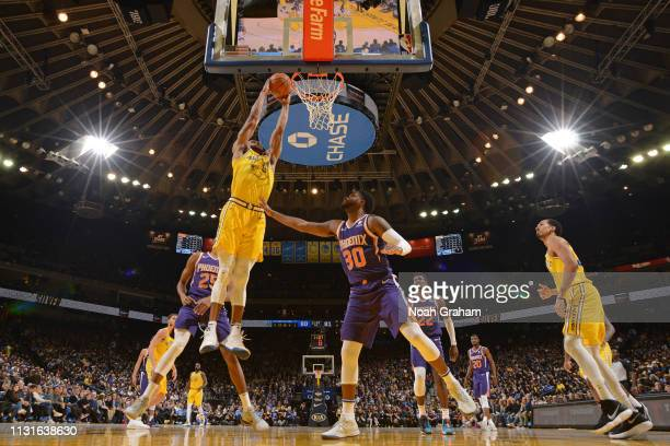 Andre Iguodala of the Golden State Warriors dunks the ball against the Phoenix Suns on March 10 2019 at ORACLE Arena in Oakland California NOTE TO...