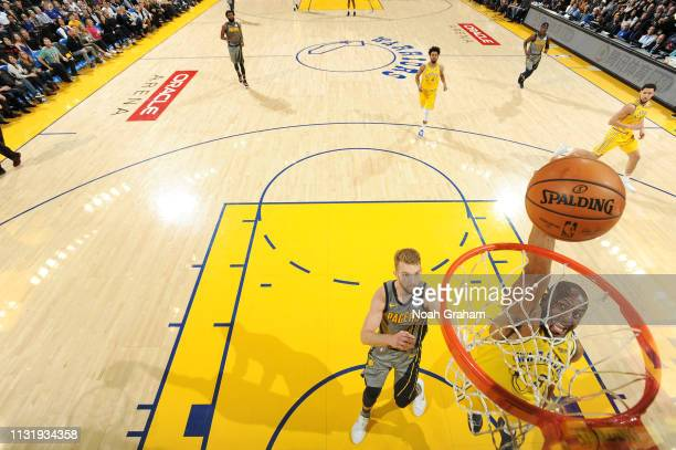 Andre Iguodala of the Golden State Warriors dunks the ball against the Indiana Pacers on March 21 2019 at ORACLE Arena in Oakland California NOTE TO...