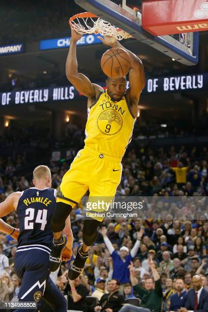 Andre Iguodala of the Golden State Warriors dunks the ball against the Denver Nuggets at ORACLE Arena on March 8 2019 in Oakland California NOTE TO...