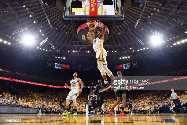 Andre Iguodala of the Golden State Warriors dunks the ball against the LA Clippers during Game One of Round One of the 2019 NBA Playoffs on April 13...