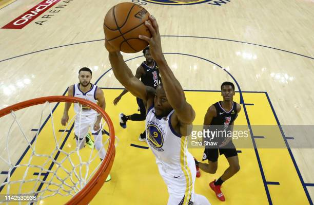 Andre Iguodala of the Golden State Warriors dunks the ball against the LA Clippers during Game One of the first round of the 2019 NBA Western...