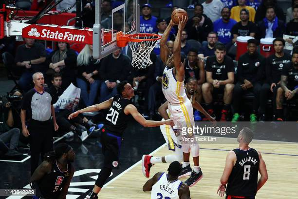 Andre Iguodala of the Golden State Warriors dunks the ball against Landry Shamet of the Los Angeles Clippers during the third quarter at Staples...