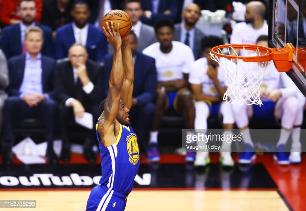 Andre Iguodala of the Golden State Warriors dunks the ball against the Toronto Raptors in the second quarter during Game One of the 2019 NBA Finals...