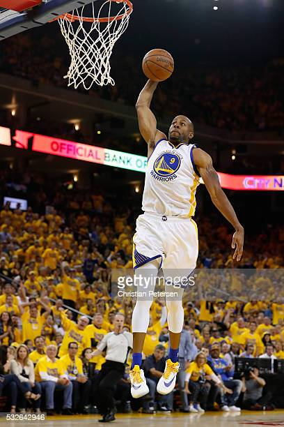 Andre Iguodala of the Golden State Warriors dunks the ball against the Oklahoma City Thunder during game two of the Western Conference Finals during...