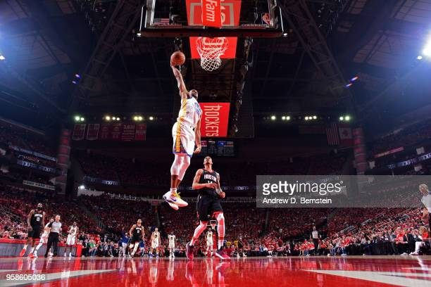 Andre Iguodala of the Golden State Warriors dunks the ball against the Houston Rockets during Game One of the Western Conference Finals of the 2018...