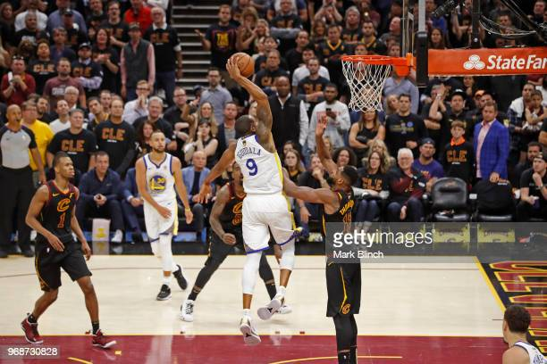 Andre Iguodala of the Golden State Warriors dunks the ball while guarded by Tristan Thompson of the Cleveland Cavaliers in Game Three of the 2018 NBA...