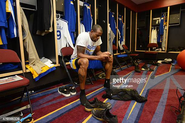 Andre Iguodala of the Golden State Warriors gets ready in the locker room before a game against the Cleveland Cavaliers during Game Three of the 2015...