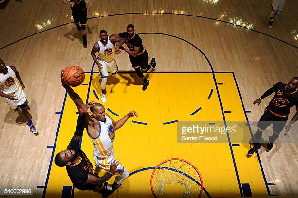 Andre Iguodala of the Golden State Warriors goes for the dunk during the game against Kyrie Irving of the Cleveland Cavaliers during Game Five of the...