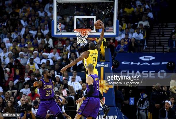 Andre Iguodala of the Golden State Warriors goes in for a slam dunk against the Los Angeles Lakers during the first half of their NBA Basketball game...