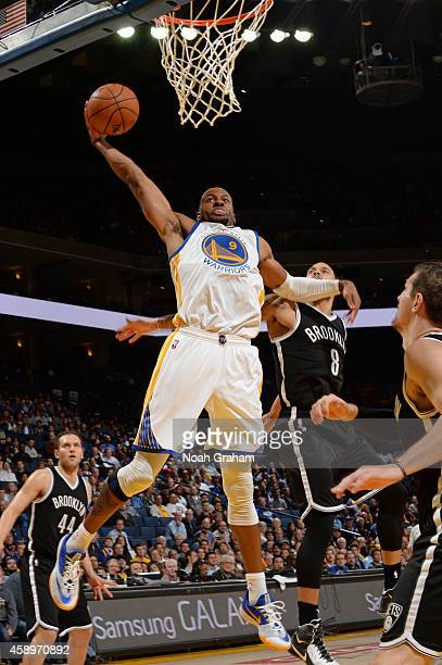 Andre Iguodala of the Golden State Warriors goes in for the dunk against the Brooklyn Nets on November 13, 2014 at Oracle Arena in Oakland,...