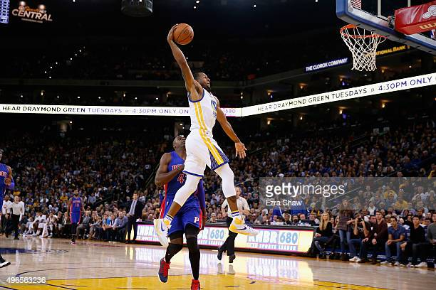 Andre Iguodala of the Golden State Warriors goes past Anthony Tolliver of the Detroit Pistons for a dunk at ORACLE Arena on November 9 2015 in...