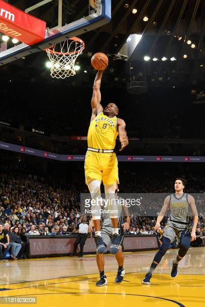Andre Iguodala of the Golden State Warriors goes to the basket for a dunk against the Indiana Pacers on March 21 2019 at ORACLE Arena in Oakland...