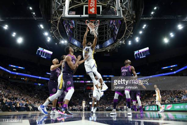 Andre Iguodala of the Golden State Warriors goes to the basket against the Minnesota Timberwolves on March 19 2019 at Target Center in Minneapolis...