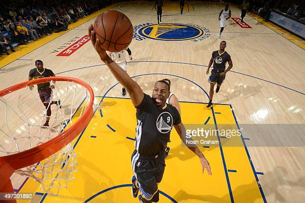Andre Iguodala of the Golden State Warriors goes to the basket against the Brooklyn Nets on November 14 2015 at Oracle Arena in Oakland California...