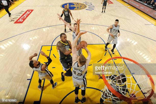 Andre Iguodala of the Golden State Warriors goes to the basket against the San Antonio Spurs on February 10 2018 at ORACLE Arena in Oakland...