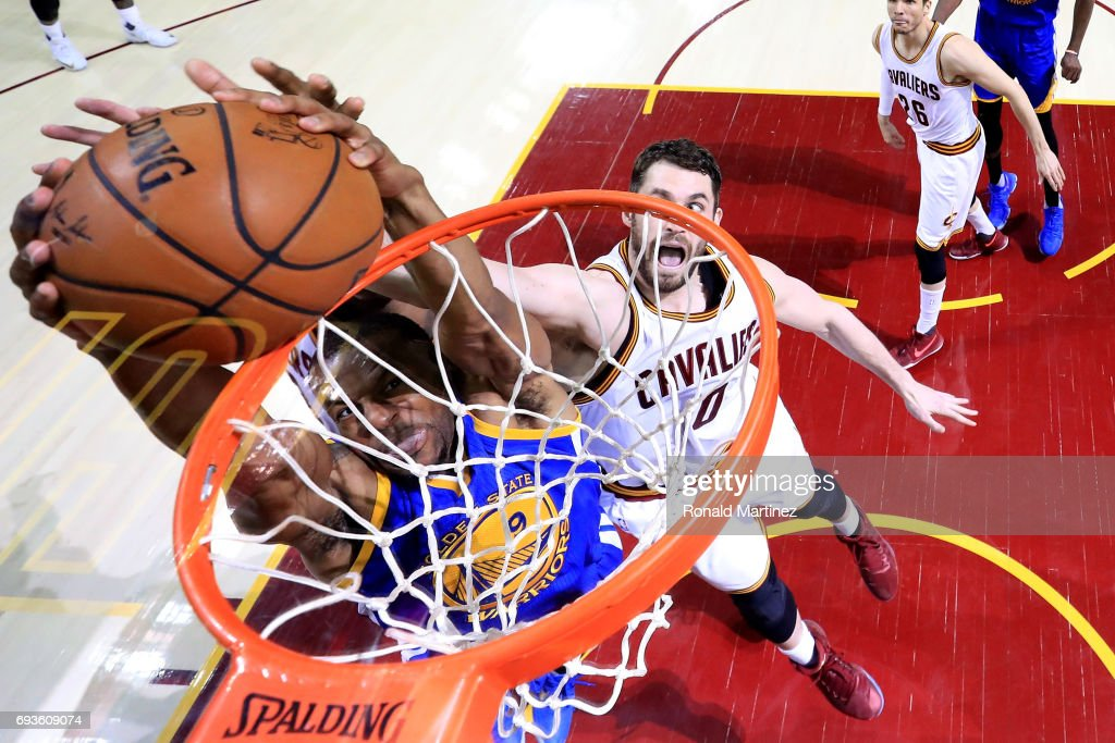 Andre Iguodala #9 of the Golden State Warriors goes up for a dunk against Kevin Love #0 of the Cleveland Cavaliers in the second half in Game 3 of the 2017 NBA Finals at Quicken Loans Arena on June 7, 2017 in Cleveland, Ohio.