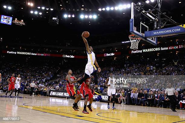 Andre Iguodala of the Golden State Warriors goes up for a dunk against the Atlanta Hawks at ORACLE Arena on March 18 2015 in Oakland California NOTE...
