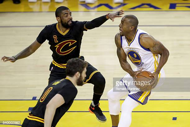 Andre Iguodala of the Golden State Warriors goes up for a shot against Kyrie Irving of the Cleveland Cavaliers during the first quarter in Game 5 of...
