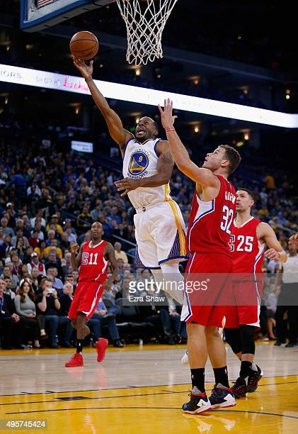 Andre Iguodala of the Golden State Warriors goes up for a shot over Blake Griffin of the Los Angeles Clippers at ORACLE Arena on November 4 2015 in...