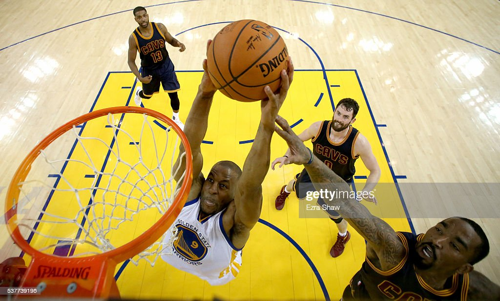Andre Iguodala #9 of the Golden State Warriors goes up to dunk the ball against J.R. Smith #5 of the Cleveland Cavaliers in the first half in Game 1 of the 2016 NBA Finals at ORACLE Arena on June 2, 2016 in Oakland, California.