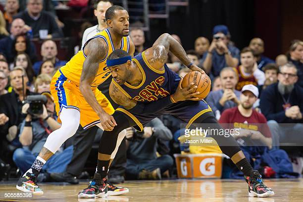 Andre Iguodala of the Golden State Warriors guards LeBron James of the Cleveland Cavaliers during the first half at Quicken Loans Arena on January 18...