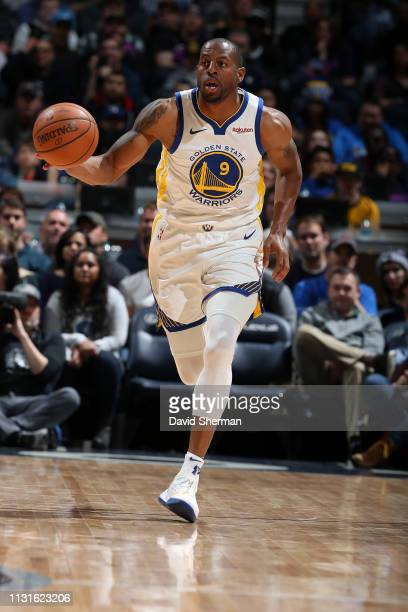 Andre Iguodala of the Golden State Warriors handles the ball against the Minnesota Timberwolves on March 19 2019 at Target Center in Minneapolis...