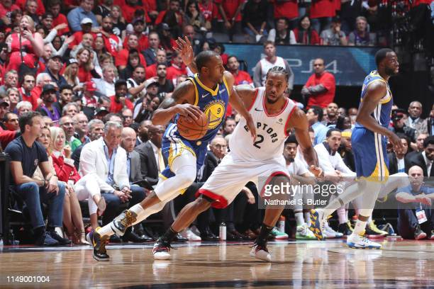 Andre Iguodala of the Golden State Warriors handles the ball against Kawhi Leonard of the Toronto Raptors during Game Five of the NBA Finals on June...