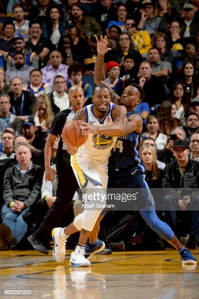 Andre Iguodala of the Golden State Warriors handles the ball against the Dallas Mavericks on December 14 2017 at ORACLE Arena in Oakland California...