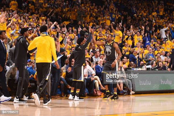 Andre Iguodala of the Golden State Warriors high fives teammates during the game against the San Antonio Spurs in Game Two of Round One of the 2018...