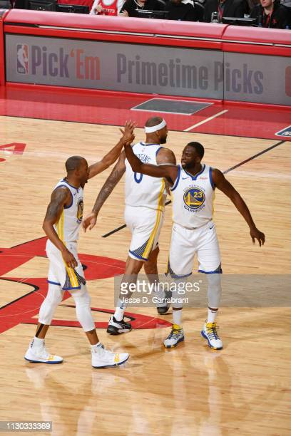 Andre Iguodala of the Golden State Warriors highfive during a game against the Houston Rockets on March 13 2019 at the Toyota Center in Houston Texas...
