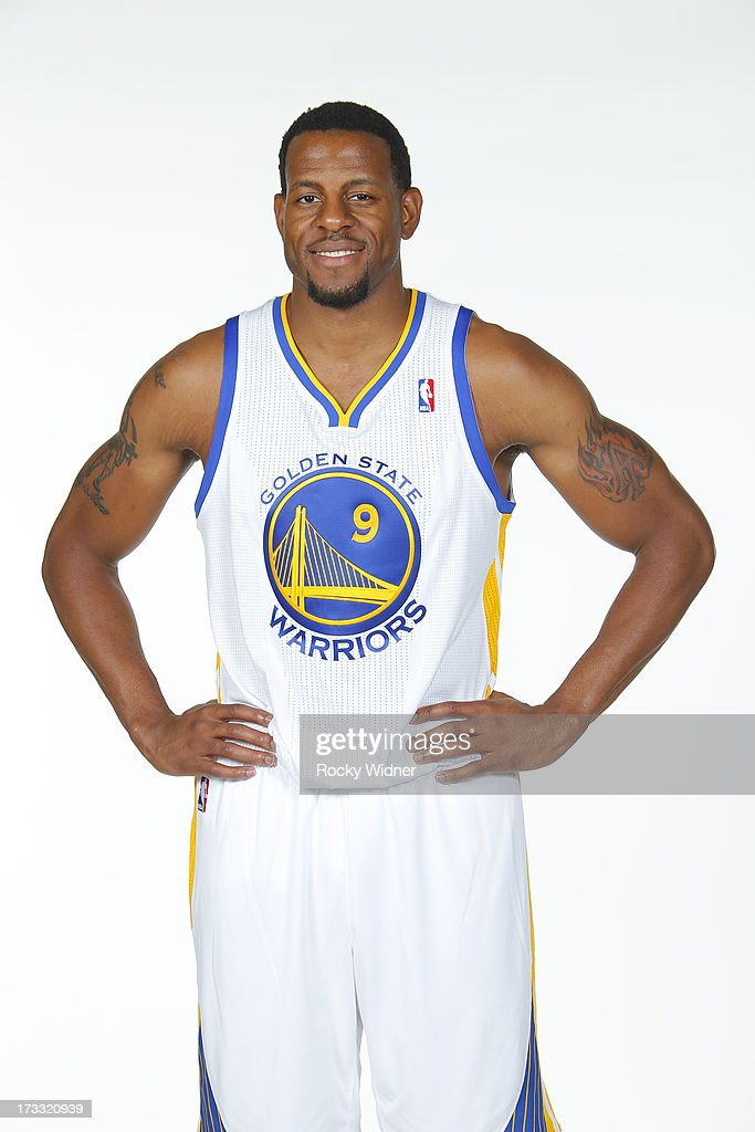 Andre Iguodala #9 of the Golden State Warriors holds up his jersey at his introductory press conference on July 11, 2013 in Oakland, California.